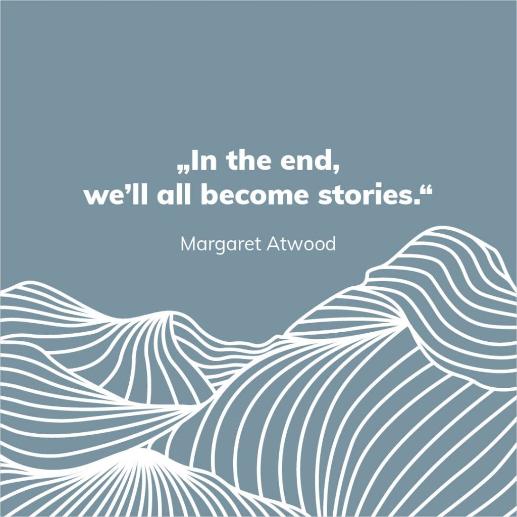 """The background is coloured with the farvel blue-grey. A scaled section of the keyvisual can be seen at the lower third. Above the quote """"In the end, we'll all become stories."""" by Margaret Atwood can be seen with a white sans-serif font."""